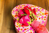Heart shaped box  Valentines Day  with red roses — Stock Photo