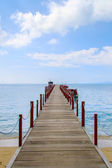 Old wood bridge pier and blue sky — Stock Photo