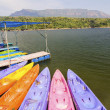 Yellow and orange Kayak on the lake — Stock Photo #72739809