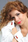 Young woman in white shirt with red racing car cufflinks — Foto Stock