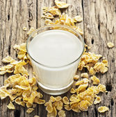 Milk and cornflake on table wooden background — Stock Photo