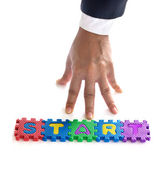 Business man hand start up with jigsaw colorful text, business concept — Stock Photo