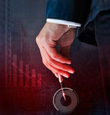 Businessman 's hand holding a pen on circuit and graph background — Stock Photo