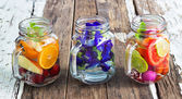 Three mug delicious refreshing drink of mix fruits and herb on wooden — Stock Photo