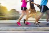 Abstract colorful people running in the park, pastel and blur concept — Stock Photo