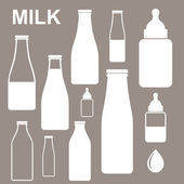 Milk Bottles — Stock Vector
