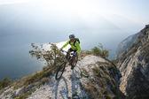 Mountainbiking over the lake garda — Stock Photo