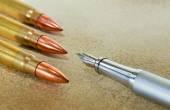 Pen and three bullets — Stock Photo