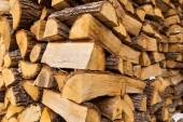 Pile of chopped firewoods — Stockfoto