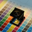 Close-up of a loupe on a test print — Stock Photo #59247945