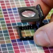 Close-up of a loupe on a colorful test print — Stock Photo #70734959