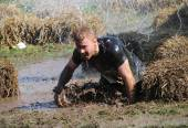 Man falling in the mud — Stock Photo
