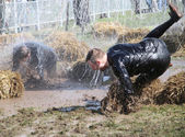 A man makes a spectacular overturn in the mud — Stock Photo