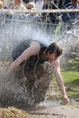 Man is squirted with water and strying to avoid the electrified  — Foto Stock
