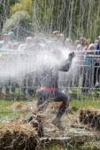 Man running into powerful douche — Stock Photo