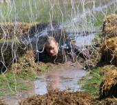 A terrified man crawling in the mud — Stock Photo