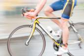Rapid blue bicycling man, sideview without torso — Stock Photo