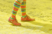 The colorful shoes and legs of one of the officials — Stock Photo