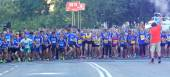 Large group of running girls and boys close-up — Stock Photo