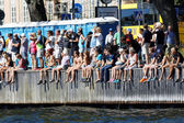 Audience watching from the quay — Stock Photo