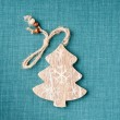 Wooden christmas tree on green fabric background — Stock Photo #51972297