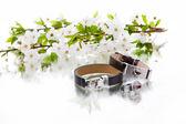 Leather bracelets with cherry branch — Stock Photo