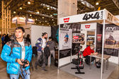 Motopark-2015 (BikePark-2015). The visitors are looking at stands. Stand of th ATV 4x4 Club. — Stockfoto