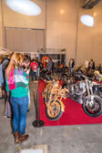 Motopark-2015 (BikePark-2015). Custom Zone. Visitors are watching on the unique motorcycles. — Стоковое фото