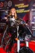 Motopark-2015 (BikePark-2015). The exhibition stand of the tuning-studio for motorcycles MGS-Moto. Beautiful girl on the motorcycle. — Stock Photo