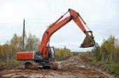 Orange excavator — Stock fotografie