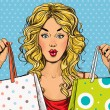 Pop Art blond women with shopping bags in the hands.Shopping Time.Sale and discount time. Black Friday.Fashion days.Pop Art girl.Hollywood movie star.Shopaholic blond girl with bags.Sale in the store. — Stock Photo #70999213