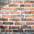 Red brick wall background and texture : closeup of an old brick — Stock Photo #74147911