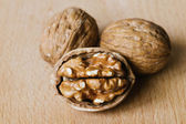 Walnuts on wooden table — Stock Photo