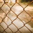 Rusty chain link fence — Stock Photo #65558611