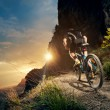 Cyclist riding mountain bike on trail at evening. — Stock Photo #52219021