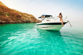 Beautiful young woman recreation on the boat a sunny summer day. Luxury vacation at sea. — Stock Photo