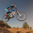 Mountain Bike cyclist jumping. Downhill biking. Extreme sports cycling. — Stock Photo #52558385
