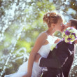 Wedding kiss in the rain — Stock Photo #53123755