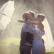 Wedding kiss in the rain. — Stock Photo #53572067