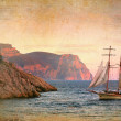 Sailing ship sails along the rocky shore, vintage style — Stock Photo #54363657