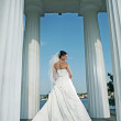 Very beautiful bride in white wedding dress with columns  — Stock Photo #61928333