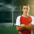 Portrait of soccer player with his arms crossed in training  — Stock Photo #62592605