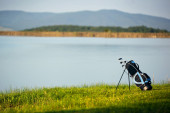 Bag with clubs on a green golf course. — Stock Photo