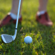Golfer hitting the ball stick up close — Stock fotografie #70605155