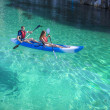 Kayaking. Young happy couple traveling by kayak. — Stock Photo #71025369