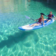 Kayaking. Young happy couple traveling by kayak. Water activities — Stock Photo #71025403