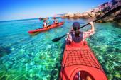Kayaking. The woman floating on the sea kayak. Canoeing. — Stock Photo