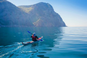 Kayak. People kayaking in the sea. Leisure activities on the calm blue water. — Stock Photo
