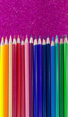 Colorful pencils on purple  background — Foto Stock