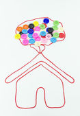 Colorful of buttons sewing with home and balloon shape on white — Stock Photo